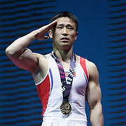 Se Gwang Ri of the People's Republic of Korea salutes his national flag as he celebrates winning gold on the Vault at the 46th FIG Artistic Gymnastics World Championships Apparatus Final in Glasgow, Britain, 1 November 2015.