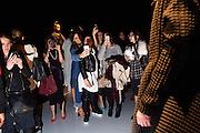 TORONTO, ON - MARCH 14: Fans take photos during the Sig Neigum show during Toronto Fashion Week in Toronto, Ontario. Toronto Star/Todd Korol