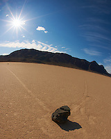 Fisheye View of the Racetrack Playa with a Sunburst and Clouds Swirling over the Sierra Mountains in Death Valley National Park, California. Image taken with a Nikon D3x and 16 mm f/2.8 fisheye lens (ISO 100, 16 mm, f/22, 1/100 sec).