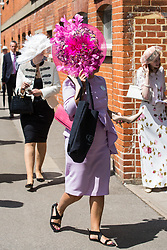 Ascot, UK. 20 June, 2019. Racegoers wearing fancy hats attend Ladies Day at Royal Ascot.