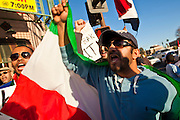 31 JANUARY 2011 - TEMPE, AZ: ALI ALBOLOUSHI leads a chant against Hosni Mubarek during a demonstration in Tempe, AZ, in support of democracy in Egypt. About 200 people marched through central Tempe, AZ, near the Arizona State University campus Monday afternoon. The rally was organized by the Arab American Association of Arizona in solidarity with the ongoing pro-democracy rallies and demonstrations in Egypt and other Arab countries.    Photo by Jack Kurtz