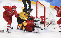 PYEONGCHANG, Feb. 25, 2018  Athletes from Germany and Olympic athletes from Russia vie for the puck during men's ice hockey final at Gangneung Hockey Centre, in Gangneung, South Korea, Feb. 25, 2018. The Olympic Athletes from Russia team defeated Germany 4:3 and won the gold medal. (Credit Image: © Han Yan/Xinhua via ZUMA Wire)