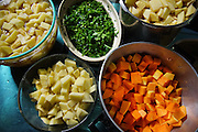 """Vegetables cooking for evening meal in kitchen<br /><br />The Freegan Pony is an alternative restaurant housed in a squat. It was founded in 2015 by Aladdin Charni with three other collaborators. The restaurant specialises in cheap vegetarian cuisine, serving meals which guests reserve a place through a Facebook group, paying €2 a meal. The restaurant meals contain unsold and donated food, collected from wholesellers at the Paris Rungis vegetable market. The Freegan Pony is located at the Porte de la Vilette on the outskirts of Paris, at the entrance to the peripherique outer circle motorway.<br /><br />Freegans are people who employ alternative strategies for living based on limited participation in the conventional economy and minimal consumption of resources. Freeganism is the practice of reclaiming and eating food that has been discarded. People who attempt to live an ethical lifestyle by reusing trash and rubbish thrown away by others.<br /><br />Freeganism is an ill-defined activity and is a subset of the larger anti-capitalist and environmental protest movements. It embraces alternative, anti-consumerist lifestyles. Freegan practices also include co-operative living, squatting and """"freecyling"""", or matching things that people want to get rid of with things other people need"""