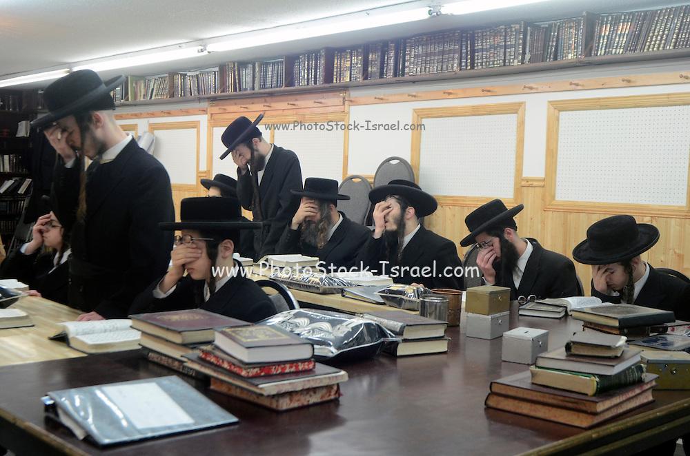 Extremist Haredi Jewish men praying, Lev Tahor (Pure Heart) community, Sainte Agathe des Monts, Quebec, Canada