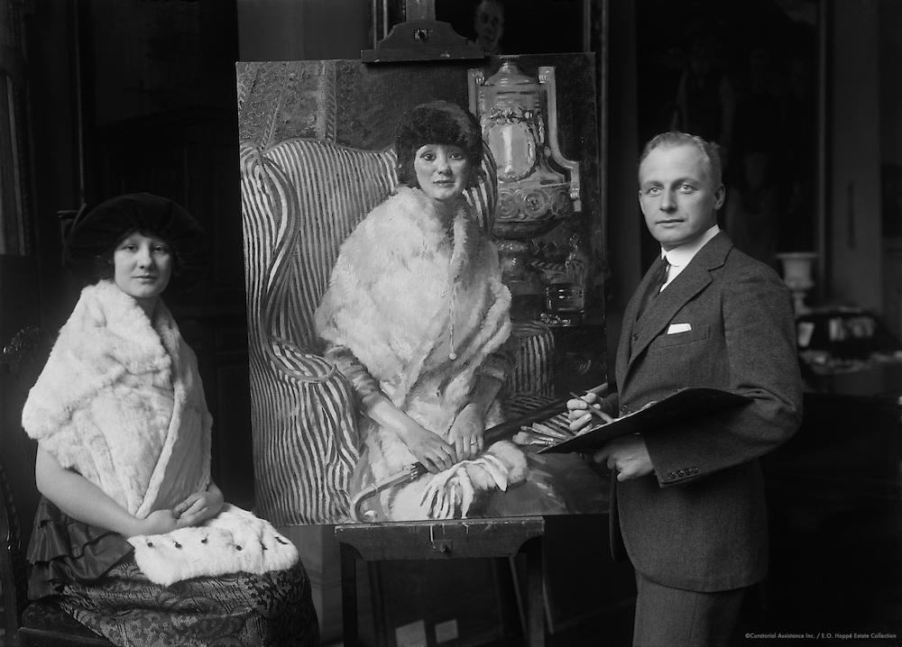 William Ranken, painter, with Maisie Hollier and her portrait, 1921