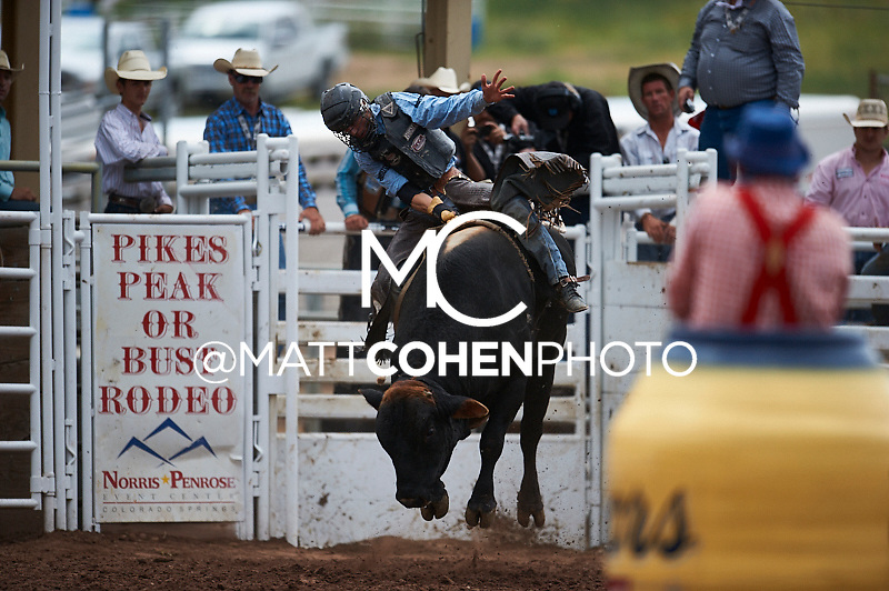Bull rider Bart Miller of Oshkosh, NE rides Shrimp at the Pikes Peak or Bust Rodeo in Colorado Springs, CO.<br /> <br /> <br /> UNEDITED LOW-RES PREVIEW<br /> <br /> <br /> File shown may be an unedited low resolution version used as a proof only. All prints are 100% guaranteed for quality. Sizes 8x10+ come with a version for personal social media. I am currently not selling downloads for commercial/brand use.