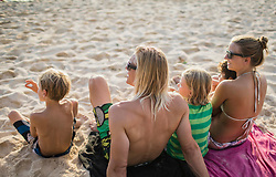 Family relaxing on the beach, Mauritius
