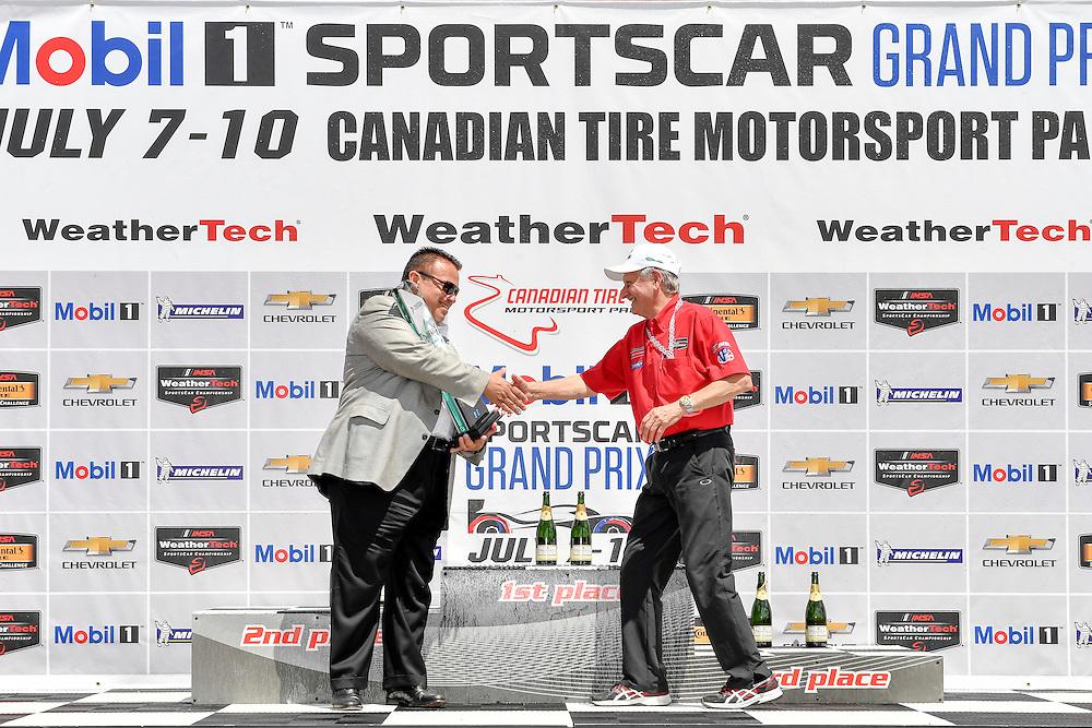 7-10 July 2016, Bowmanville, Ontario Canada<br /> Don Nicholson, president and CEO of DEKRA North America presents the DEKRA Green Award<br /> ©2016, Scott R LePage <br /> LAT Photo USA