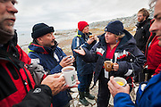 Polish sailors warm up with coffee and tea with scientists at the Polish research station in Hyttevika, Svalbard.
