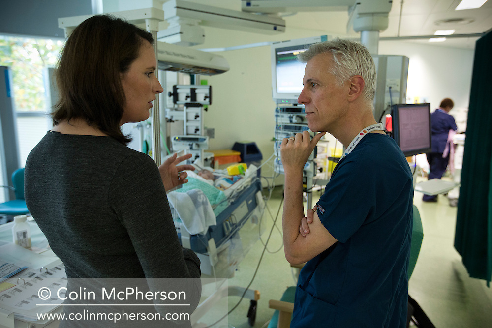 Kathryn Jones discusses the condition of her three-and-a-half-week-old son Finn with consultant Dr Tim Watts at the paediatric intensive care unit at Evelina London Children's Hospital in central London. The son of Philip and Kathryn Jones from Canterbury, Kent, Finn was born with a pre-diagnosed condition which required a life-saving, five-hour heart 'switch' operation to be carried out within the first two weeks of his life. The operation, which took place when Finn was 10 days old was successful, however, due to other near fatal complications the his recovery during the subsequent six weeks was slow and difficult.