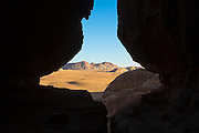 View of the desert outside from inside a cave in Wadi Rum, Jordan.