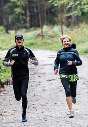 Alenka Teran Kosir and Peter Kastelic at recreational running after rain on September 30, 2013 in Mostec, Ljubljana, Slovenia. (Photo by Vid Ponikvar / Sportida.com)