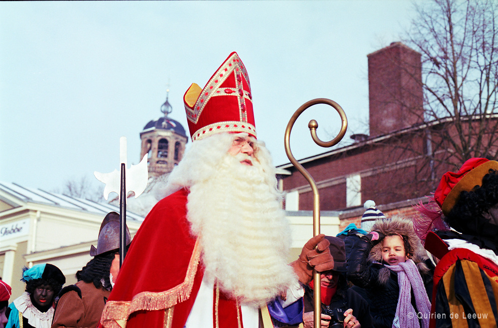 Arrival of Sint Nicolaas, Deventer town. Sinterklaas or Sint-Nicolaas is a legendary figure based on Saint Nicholas. The feast is celebrated annually with the giving of gifts on St. Nicholas' Eve on 5 December.
