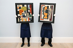 © Licensed to London News Pictures. 29/01/2020. LONDON, UK. Technicians present (L to R) ''Nature Morte'' (Est. £2,200,000 - 2,800,000) and ''Le Buste'' (Est. £1,300,000 - 1,600,000) both by by Fernand Léger. Preview of Sotheby's Impressionist & Modern and Surrealist Art sales.  The auction will take place at Sotheby's New Bond Street on 4 and 5 February 2020.  Photo credit: Stephen Chung/LNP