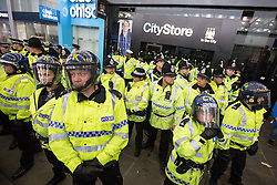 © Licensed to London News Pictures . 13/05/2013 . Manchester , UK . Police confront 100s of Manchester United fans outside the Manchester City store on Market Street after the Manchester United victory parade , this evening (13th May 2013) Photo credit : Joel Goodman/LNP