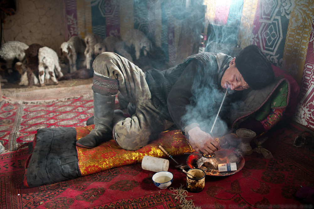 Aziz, one of the son of the late Khan, during one of his 3 daily opium smoking session, in his home. He is completely addicted, having smoked regularly since the last 8 years.