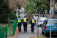 Police are seen patrolling the parameter of 12 Sutton Street amid a full and total lockdown of 9 housing commission high rise towers in North Melbourne and Flemington during COVID-19 on 5 July, 2020 in Melbourne, Australia. After 108 new cases where uncovered overnight, the Premier Daniel Andrews announced on July 4 that effective at midnight last night, two more suburbs have been added to the suburb by suburb lockdown being Flemington and North Melbourne. Further to that, nine high rise public housing buildings in these suburbs have been placed under hard lockdown for a minimum of five days, effective immediately.  Residents in these towers will not be allowed to leave their units for any reason. Police will be stationed at every entry and exit point, every level, and they will also surround these locations preventing any movement in, or out. There is a total of 1354 units and over 3000 residents living in these buildings including the states most vulnerable people. These new restrictions will remain in place for fourteen days with fears of further lockdowns to come. The Government have stressed that if Victorians do not follow the basic COVIDSafe rules, the whole state will go back in to lockdown. (Image by Dave Hewison/ Speed Media)