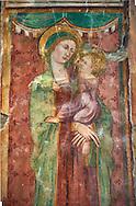 14th century Madonna with Child Fresco in the Basilica Church of Santa Maria Maggiore, Tuscania .<br /> <br /> Visit our ITALY PHOTO COLLECTION for more   photos of Italy to download or buy as prints https://funkystock.photoshelter.com/gallery-collection/2b-Pictures-Images-of-Italy-Photos-of-Italian-Historic-Landmark-Sites/C0000qxA2zGFjd_k .<br /> <br /> Visit our MEDIEVAL PHOTO COLLECTIONS for more   photos  to download or buy as prints https://funkystock.photoshelter.com/gallery-collection/Medieval-Middle-Ages-Historic-Places-Arcaeological-Sites-Pictures-Images-of/C0000B5ZA54_WD0s