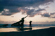 CS00626-09. Photographer at the wreck of the Peter Iredale, at Clatsop Spit, Oregon. July 7, 1957.