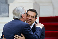 April 26, 2018 - Athens, Greece - Greek Prime Minister ALEXIS TSIPRAS WELCOMES the President of the European Commission JEAN CLAUDE JUNCKER with hug and kiss prior to their meeting in Athens. Jean Claude Juncker is in Athens on an one-day official visit. (Credit Image: © Aristidis Vafeiadakis via ZUMA Wire)