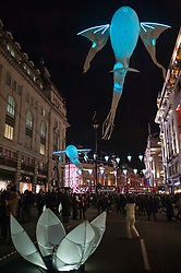 """© Licensed to London News Pictures. 14/01/2016. London, UK. """"Les Luminéoles"""" by Porté par le vent in Piccadilly.  The work forms part of Lumiere London, a major new light festival which commenced today to be held over four evenings and featuring artists who work with light.  The event is produced by Artichoke and supported by the Mayor of London.  Photo credit : Stephen Chung/LNP"""