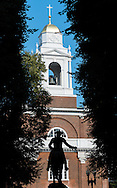 A silhouette of Paul Revere's statue with the Old North Church in the background in Boston.
