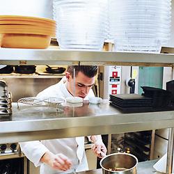 Chef Xavier Caussade cooking a dish (beef cheeks) with truffle in the kitchen at Maison de la Truffe. Paris, France. Nov. 29, 2018. <br /> Le Chef Xavier Caussade prepare un plat avec de la truffe (joue de boeuf) dans les cuisines de la Maison de la Truffe. Paris, France. 29 novembre 2018.