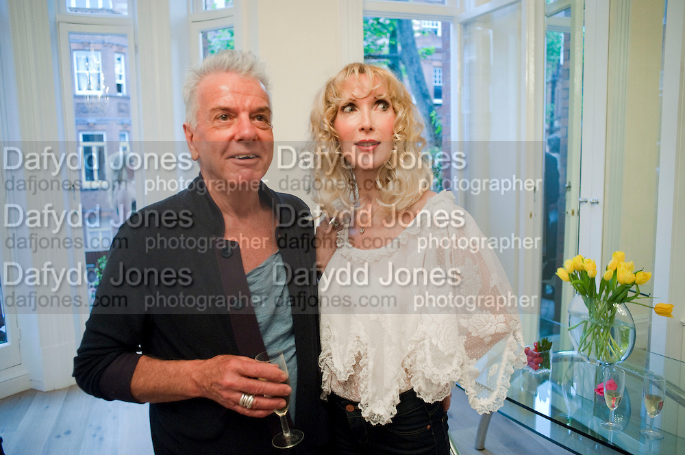 NICKY HASLAM; BASIA BRIGGS, Drinks party hosted by Basia Briggs. Sloane Gdns. London. 24 May 2010. -DO NOT ARCHIVE-© Copyright Photograph by Dafydd Jones. 248 Clapham Rd. London SW9 0PZ. Tel 0207 820 0771. www.dafjones.com.