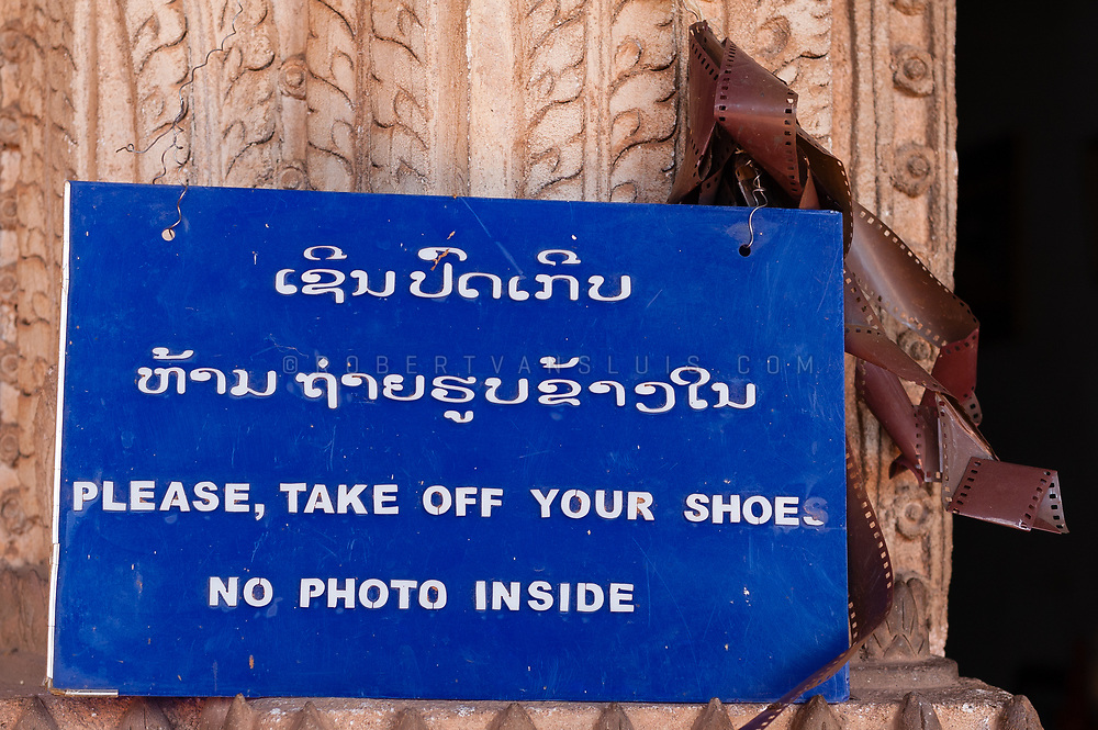 Sign in the Wat Si Saket Temple, Vientiane, Laos. Photo © robertvansluis.com