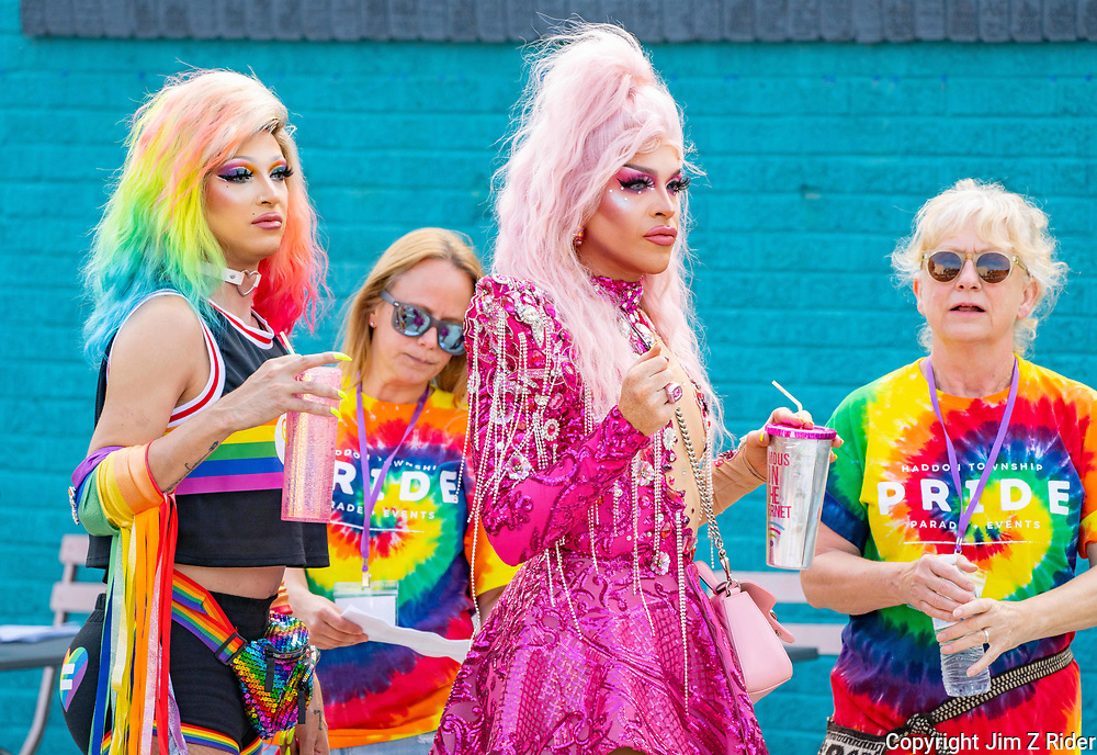 Franchesca Frose, left, and Ariel Versace, both of Cherry Hill, New Jersey, prepare to enter the Haddon Township Pride Parade in downtown Collingswood, New Jersey.