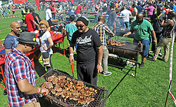 Cape Town - 130924 - National Braai Day and Castle Lager hosted an event at South African Breweries, Newlands, in an attempt to break the world record for the most people braaing at the same time. The current record sits at 2311 people and was adjudicated and verified on 25 September 2011 in Chiba, Japan. Reporter: Natasha Bezuidenhout Picture: David Ritchie