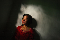 Portrait of Iriana Sohan, 43, whose young sister-in-law died in her house from an unsafe abortion, Jakarta, Indonesia, April 25, 2006. Over two million abortions are performed in Indonesia every year, many by unskilled practitioners. Thousands of women survive but often with life-long disabilities. It is said by doctors and activists that a woman dies every hour in Indonesia due to unsafe abortions.