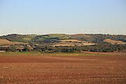Farming landscape with wind turbines in distance, Vejer de la Frontera, Cadiz province, Spain