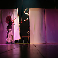 """The Palestinian Circus School members perform during the show """"Circus behind the wall"""" in Ramallah, November 20, 2009. The circus group was established in 2006, in order to give a new way of expression for Palestinians, and a new way to deliver the idea of resistance to the occupation. This performance shows the life of Palestinians behind the separation wall. Photo by Michal Fattal/Backyard"""