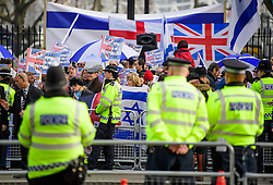 © Licensed to London News Pictures. 06/02/2017. London, UK. Police watch over a pro Israel demonstration at the gates to Downing Street in London ahead of a meeting between Israeli Prime Minister Benjamin Netanyahu and British Prime Minister Theresa May in Downing Street. Photo credit: Ben Cawthra/LNP