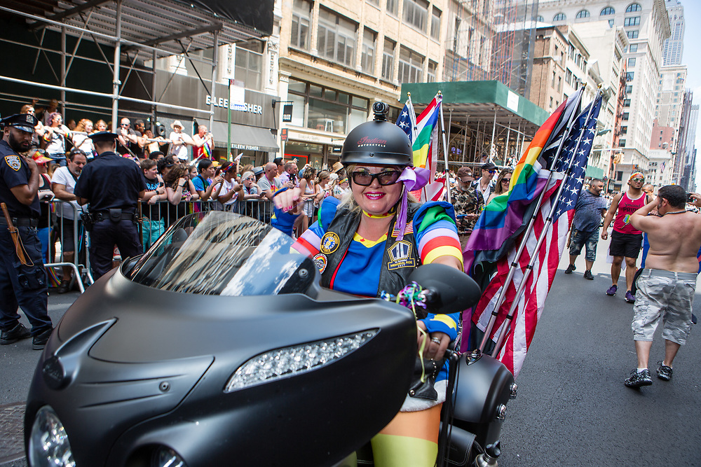 New York, NY - 30 June 2019. The New York City Heritage of Pride March filled Fifth Avenue for hours with participants from the LGBTQ community and it's supporters. Motorcycles led the march, in this photo a woman riding an Indian.