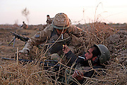 """Mcc0018931 . Daily Telegraph..A British soldier takes a light from an Afghan whilst on a joint patrol into Taliban held territory in Babaji, Helmand Province..During the patrol there were two """"contacts"""" when the Taliban opened fire from their compounds but fortunately no-one was injured...Afghanistan 14 November 09."""