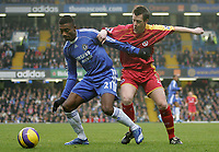 Photo: Lee Earle.<br /> Chelsea v Reading. The Barclays Premiership. 26/12/2006. Chelsea's Salomon Kalou (L) battles with Nicky Shorey.