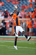 Denver Broncos wide receiver Emmanuel Sanders (10) jumps and catches a pass while warming up before the 2016 NFL week 1 regular season football game against the Carolina Panthers on Thursday, Sept. 8, 2016 in Denver. The Broncos won the game 21-20. (©Paul Anthony Spinelli)