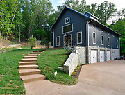 The concrete steps wind up to the entrance of the Missouri dairy barn-style home of Steve and Jennifer Schatz of rural Pacific. <br /> Photo by Tim Vizer