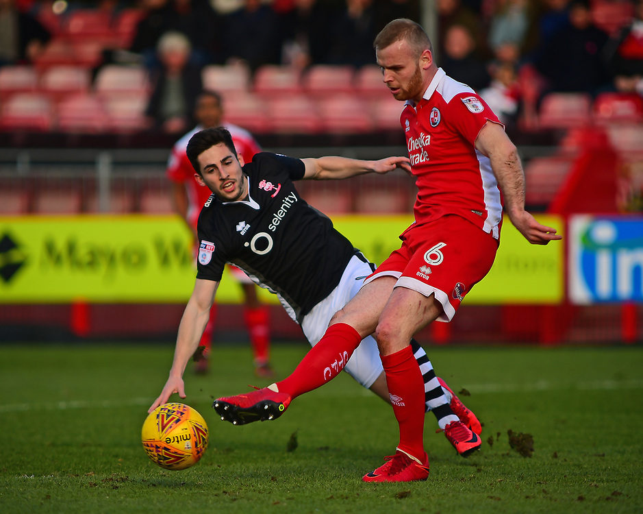 Lincoln City's Tom Pett vies for possession with Crawley Town's Mark Connolly<br /> <br /> Photographer Andrew Vaughan/CameraSport<br /> <br /> The EFL Sky Bet League Two - Crawley Town v Lincoln City - Saturday 17th February 2018 - Broadfield Stadium - Crawley<br /> <br /> World Copyright © 2018 CameraSport. All rights reserved. 43 Linden Ave. Countesthorpe. Leicester. England. LE8 5PG - Tel: +44 (0) 116 277 4147 - admin@camerasport.com - www.camerasport.com