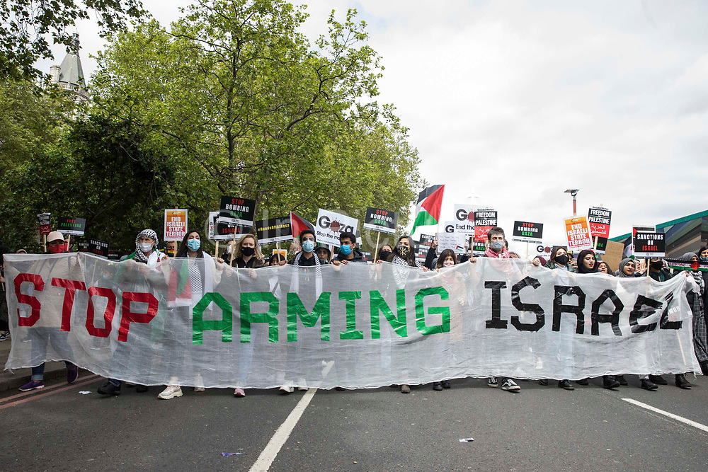 Activists march behind a Stop Arming Israel banner during the National Demonstration for Palestine from Victoria Embankment to Hyde Park on 22nd May 2021 in London, United Kingdom. The demonstration was organised by pro-Palestinian solidarity groups in protest against Israels recent attacks on Gaza, its incursions at the Al-Aqsa mosque and its attempts to forcibly displace Palestinian families from the Sheikh Jarrah neighbourhood of East Jerusalem.