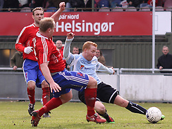 FODBOLD: Dennis Jensen (DMI) forsøger at blokere afslutning fra Ronni Andersen (Helsingør) under kampen i Danmarksserien, pulje 1, mellem Elite 3000 Helsingør - Døllefjelde-Musse IF den 5. april 2010 på Helsingør Stadion. Foto: Claus Birch