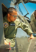 A US Navy helicopter crewman explains an aerial maneuver during an open house event at Atlanta's Dekalb Peachtree Airport (PDK).  <br />