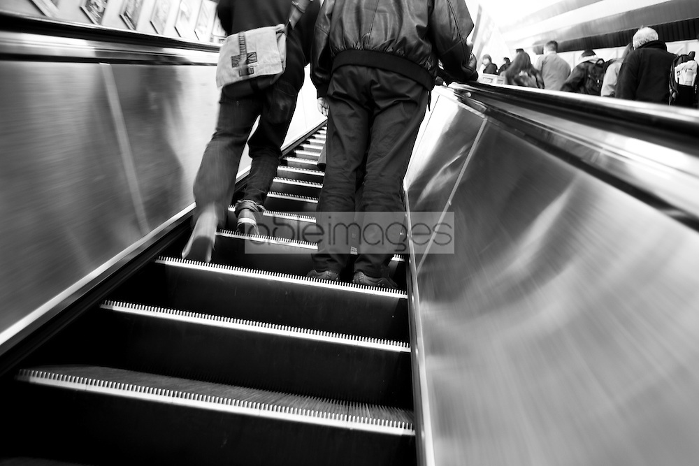 Back View of Two People on Underground Escalator