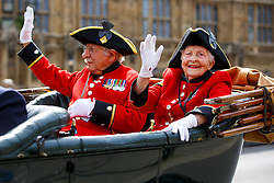 © Licensed to London News Pictures. 04/08/2014. LONDON, UK. Chelsea pensioners driving past the Houses of Parliament as they take part in The Great War Centenary Parade, a procession of over 40 Edwardian cars, all of which would have been on the road during the Great War. The procession marks the 100th year since Great Britain declared war on Germany in WW1. Photo credit : Tolga Akmen/LNP