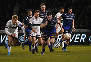 Sale Sharks flanker Ben Curry hacks the ball on as he breaks past London Irish wing Ollie Hassell-Collins during a Gallagher Premiership Rugby Union match, won by Sharks 39-0, Friday, Mar. 6, 2020, in Eccles, United Kingdom. (Steve Flynn/Image of Sport)