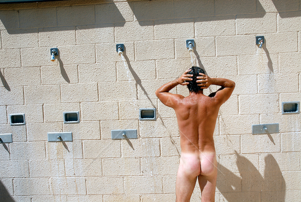 naked man in a public shower