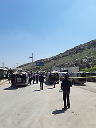 April 4, 2017 - Hatay, Hatay Province, Turkey - Ambulances gather to help victims of a nerve gas attack (possibly the powerful and lethal sarin nerve gas) in north-western Syria. First reports place the death toll at 70 to 100, many childern. Several reported that airstrikes had targeted clinics treating the wounded. Khan Sheikhoun, Idhib Province is a rebel-held town of 165,000. Around 30 Turkish ambulances came to the border in Hatay Province, Turkey for medical evacuation of victims after the Syrian toxic gas attack, then to be brought to Turkish medical aid. (Credit Image: © Ferhat Dervisoglu/Depo Photos via ZUMA Wire)