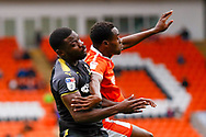 Wimbledon defender Adedeji Oshilaja (4) challenges in the box during the EFL Sky Bet League 1 match between Blackpool and AFC Wimbledon at Bloomfield Road, Blackpool, England on 20 October 2018.